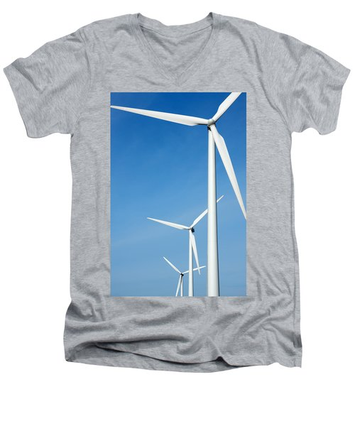 Three Mighty Windmills In A Row Against A Blue Sky. Men's V-Neck T-Shirt
