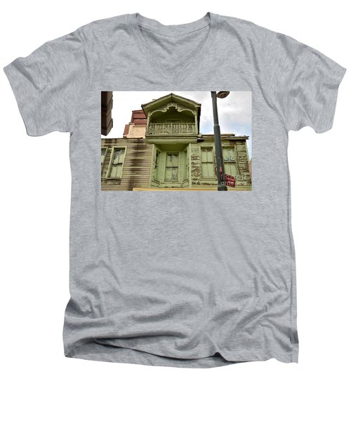 Men's V-Neck T-Shirt featuring the photograph Weathered Old Green Wooden House by Imran Ahmed