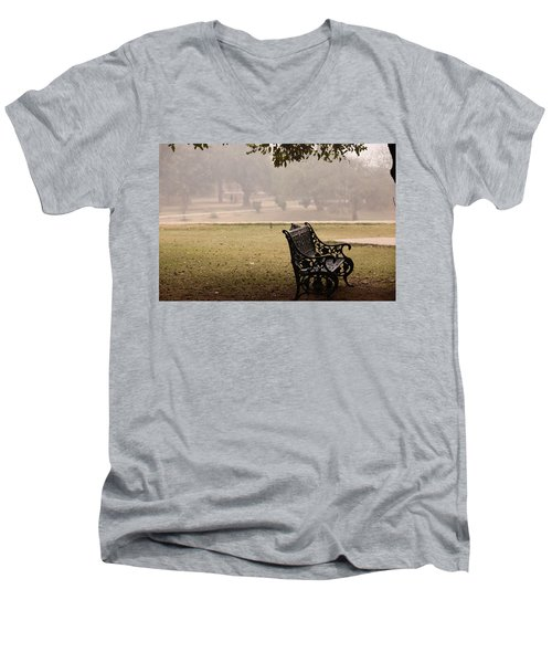 A Wrought Iron Black Metal Bench Under A Tree In The Qutub Minar Compound Men's V-Neck T-Shirt by Ashish Agarwal