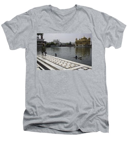 Men's V-Neck T-Shirt featuring the photograph Clearing The Sarovar Inside The Golden Temple Resorvoir by Ashish Agarwal