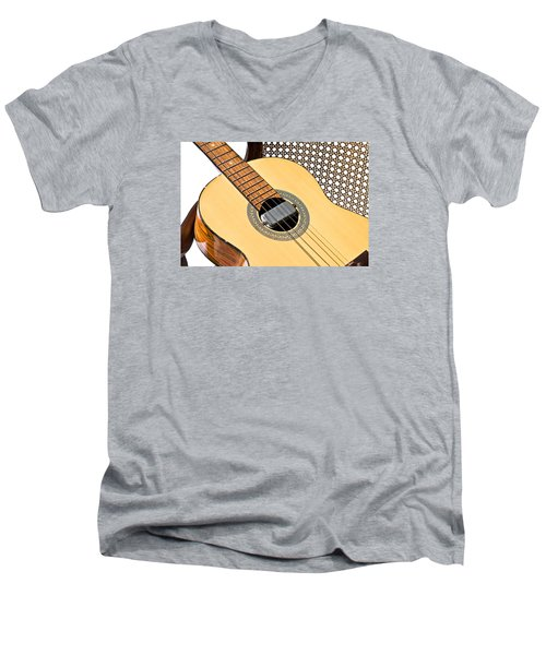 Men's V-Neck T-Shirt featuring the photograph Old Guitar In A Chair by Susan Leggett