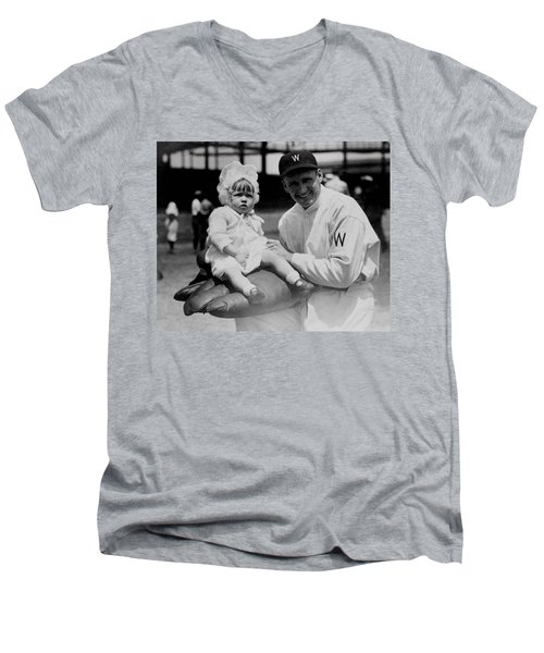 Men's V-Neck T-Shirt featuring the photograph Walter Johnson Holding A Baby - C 1924 by International  Images