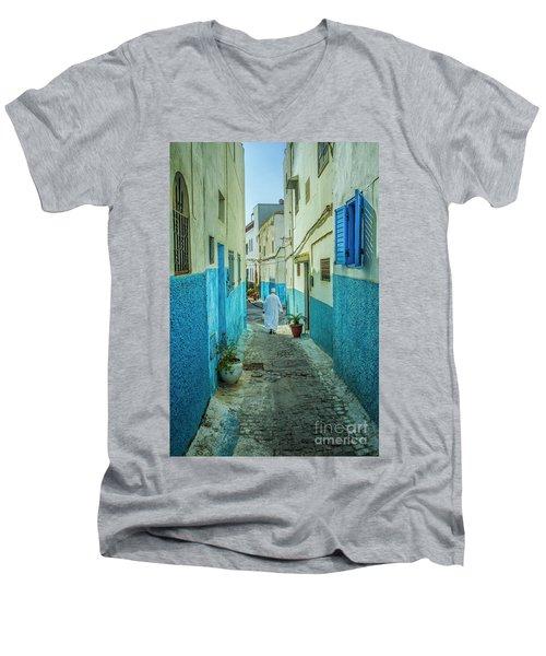 Man In White Djellaba Walking In Medina Of Rabat Men's V-Neck T-Shirt by Patricia Hofmeester