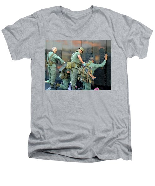 Men's V-Neck T-Shirt featuring the photograph Veterans At Vietnam Wall by Carolyn Marshall