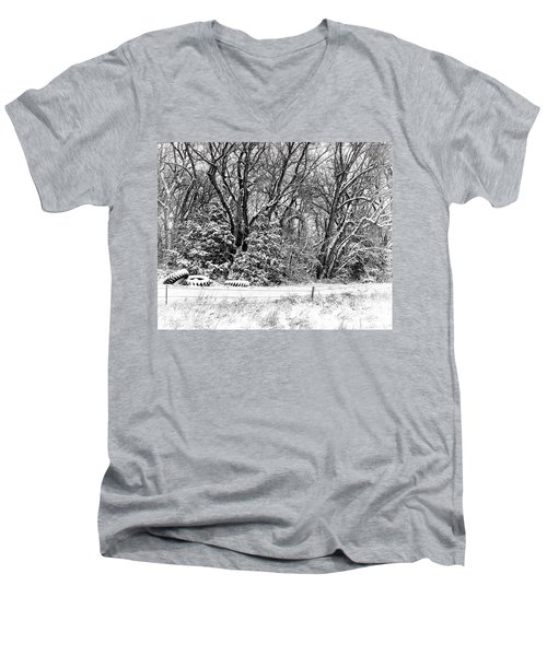 Three Tires And A Snowstorm Men's V-Neck T-Shirt by Bill Kesler