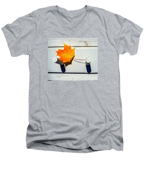 Men's V-Neck T-Shirt featuring the photograph Autumn Leaf On Pegs by Gary Slawsky