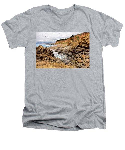 California Coast Rocks Cliffs And Beach Men's V-Neck T-Shirt by Dan Carmichael