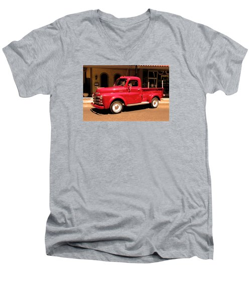 Men's V-Neck T-Shirt featuring the photograph Lil Red Truck On A Dusty Street by Spyder Webb