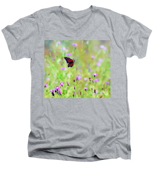 Men's V-Neck T-Shirt featuring the photograph Monarch Butterfly In Flight Over The Wildflowers by Kerri Farley