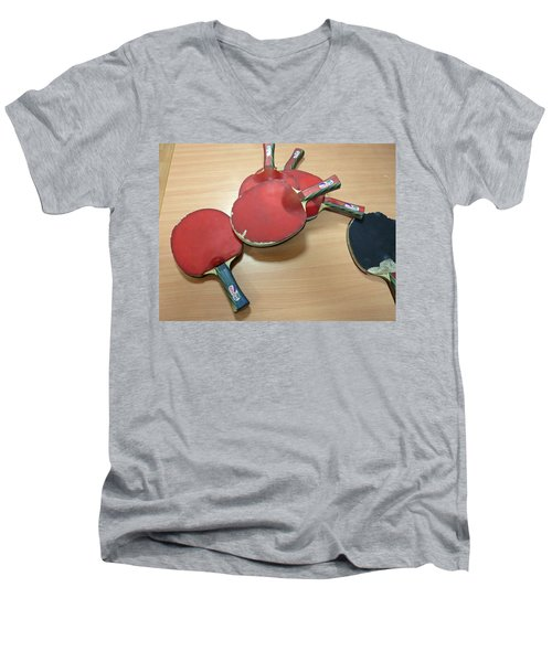 Number Of Ping Pong Bats Piled On A Table Men's V-Neck T-Shirt