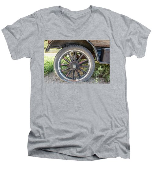 Men's V-Neck T-Shirt featuring the photograph Old Truck Tire In Rural Rocky Mountain Town by Peter Ciro