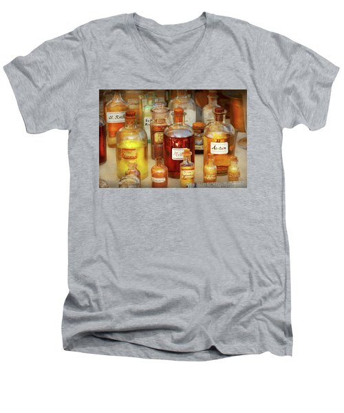 Men's V-Neck T-Shirt featuring the photograph Pharmacy - Serums And Elixirs by Mike Savad