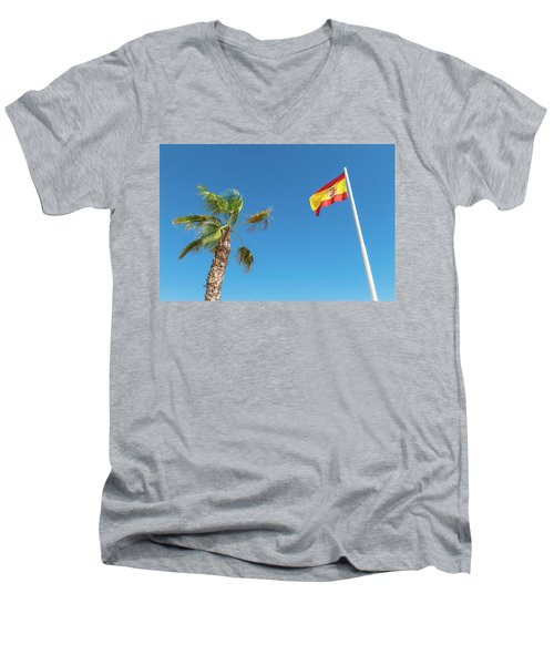 Spanish Flag And Palm Tree In The Blue Sky Men's V-Neck T-Shirt by GoodMood Art