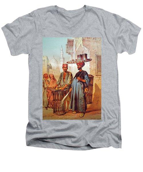 Men's V-Neck T-Shirt featuring the photograph Tea Seller by Munir Alawi