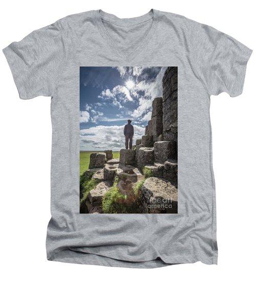 Men's V-Neck T-Shirt featuring the photograph Teen Boy Standing On Basalt Rocks by Edward Fielding