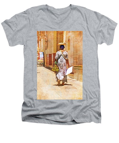 Men's V-Neck T-Shirt featuring the photograph The Jewelry Seller - Malaga Spain by Mary Machare