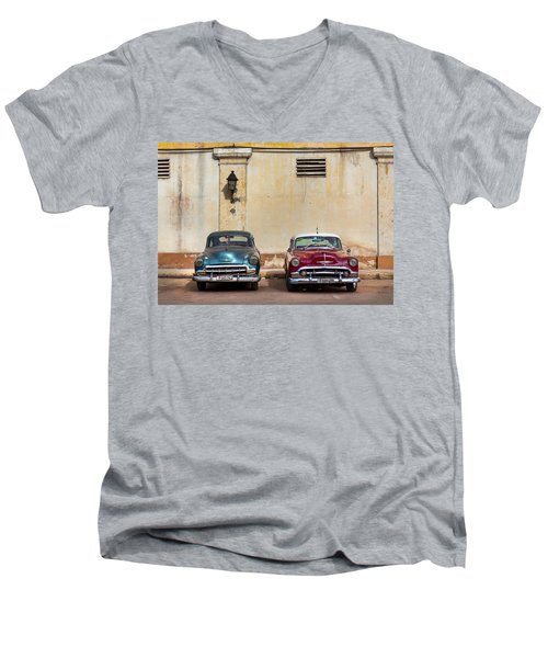 Men's V-Neck T-Shirt featuring the photograph Two Old Vintage Chevys Havana Cuba by Charles Harden
