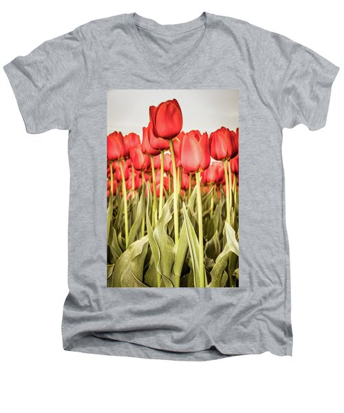 Men's V-Neck T-Shirt featuring the photograph Red Tulip Field In Portrait Format. by Anjo Ten Kate