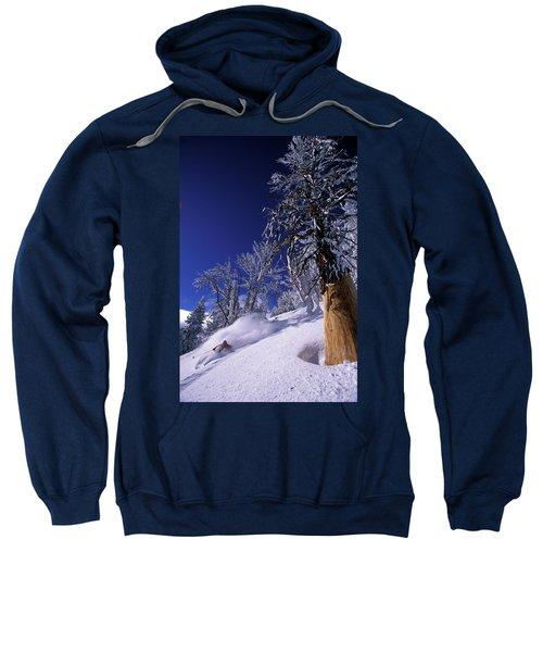 Man Skiing Through Trees In Fresh Sweatshirt