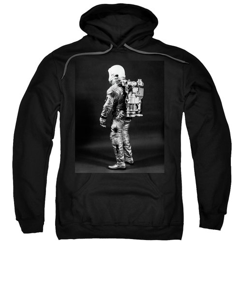 1960s Side View Of Astronaut Wearing Sweatshirt