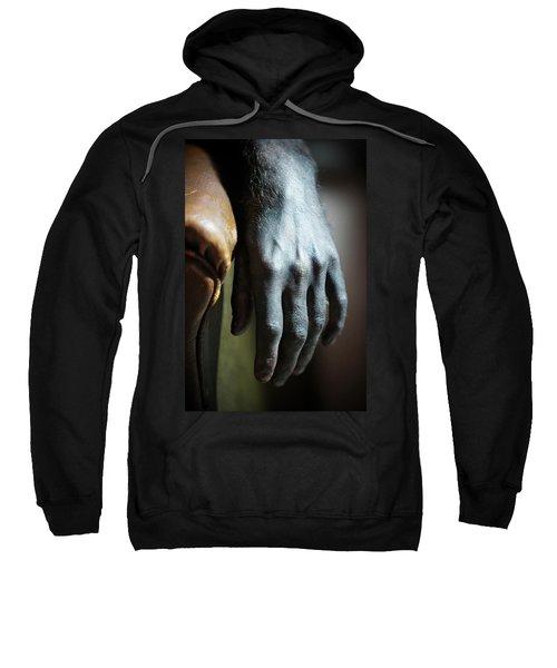 A Hand Laying On Armrest Sweatshirt