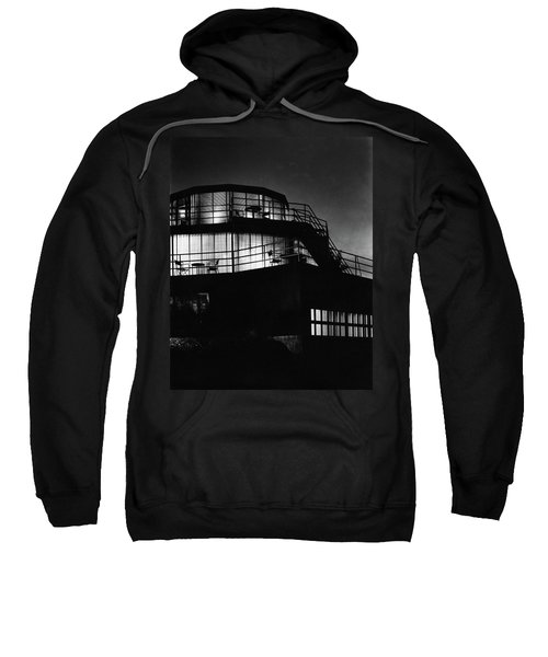 The Exterior Of A Spiral House Design At Night Sweatshirt