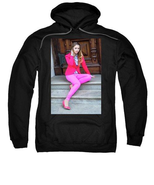 Girl Dressing In Pink Sweatshirt