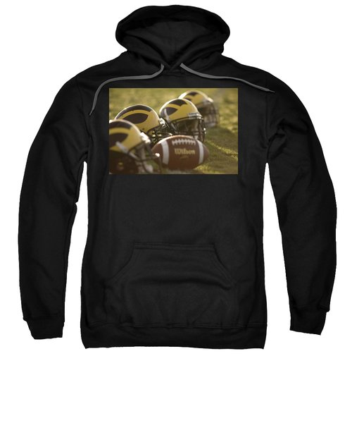 Helmets And A Football On The Field At Dawn Sweatshirt
