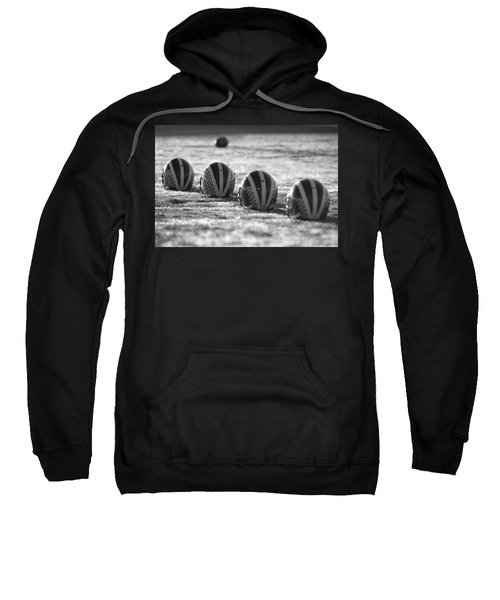 Helmets On Dew-covered Field At Dawn Black And White Sweatshirt