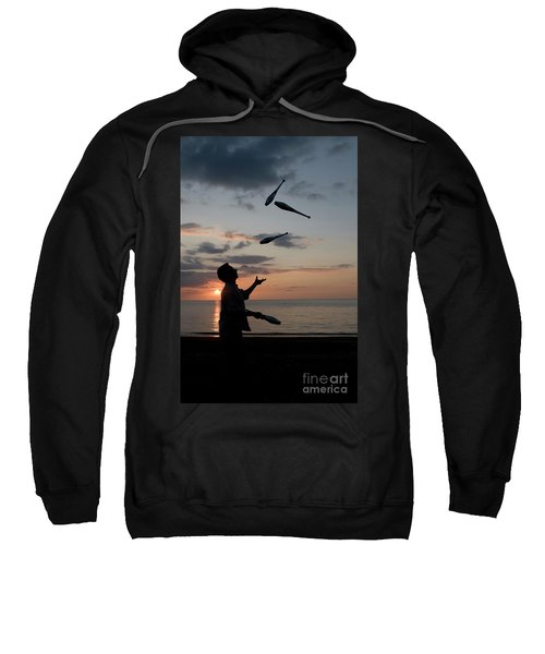 Man Juggling With Four Clubs At Sunset Sweatshirt