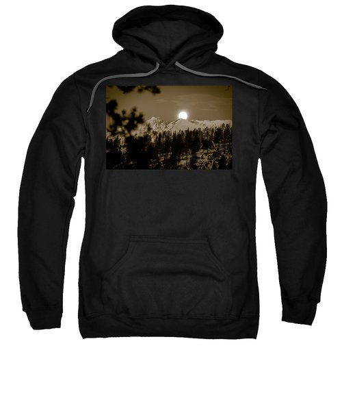 Sweatshirt featuring the photograph moonset over the Rockies by Stephen Holst