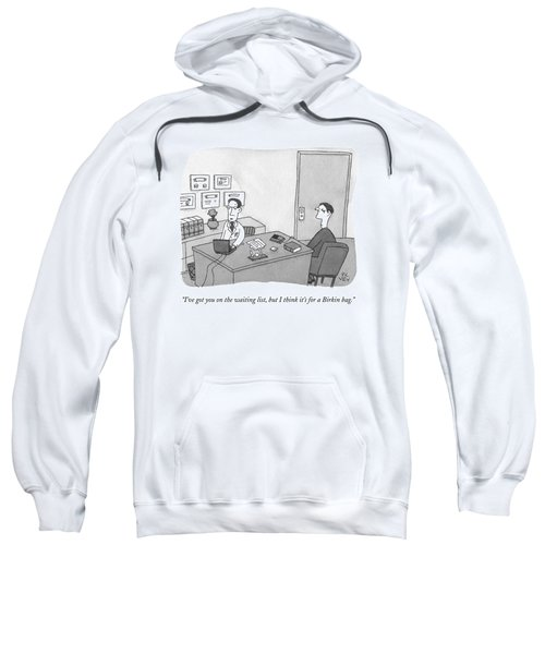 A Doctor Speaks To A Patient In His Office Sweatshirt