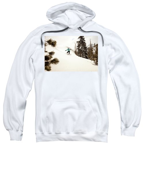 A Female Snowboarder Lays Out Some Sweatshirt