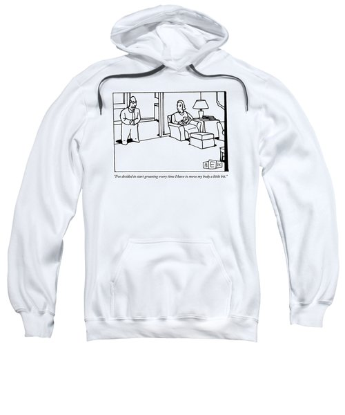 A Husband Says To His Wife In Their Livingroom Sweatshirt