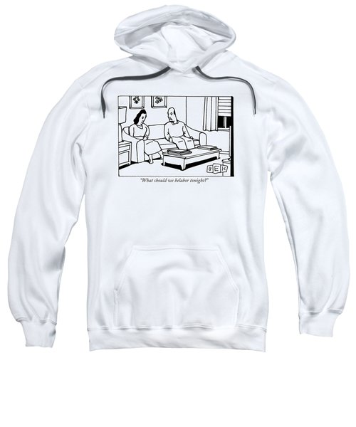 A Husband Talks To His Wife In Their Living Room Sweatshirt