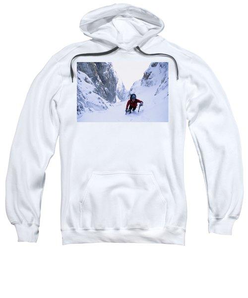 A Lone Climber Ascends A Steep Snow Sweatshirt
