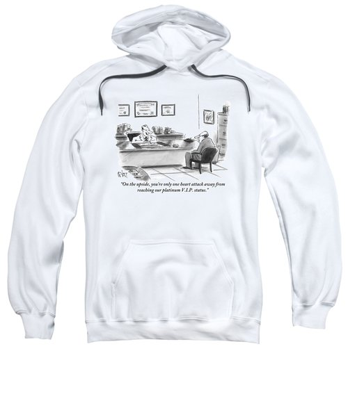A Man Is Seen Sitting And Talking With A Doctor Sweatshirt