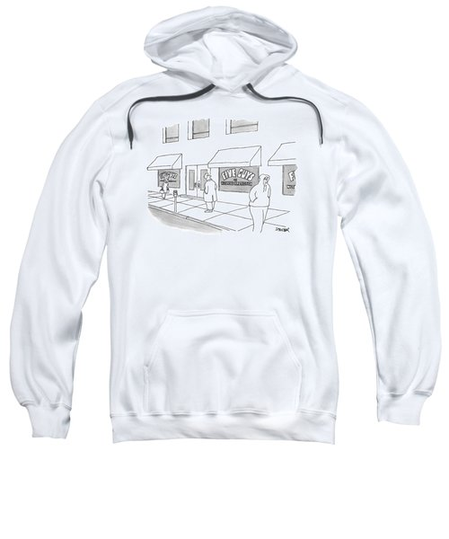 A Man On The Sidewalk Notices The Storefront Sweatshirt
