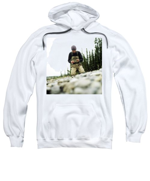A Man Ties A Fly Beside The Bow River Sweatshirt