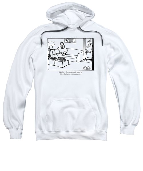 A Man Using A Laptop On A Couch Talks To A Woman Sweatshirt