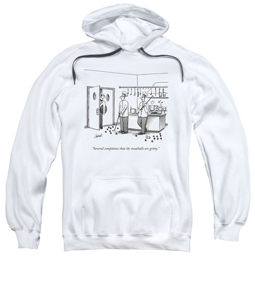 A Waiter Speaks To Two Chefs In A Kitchen Who Sweatshirt