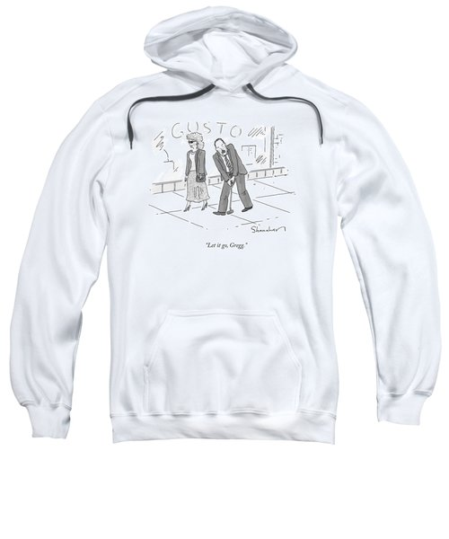 A Woman And A Man Walk Side By Side. The Man Sweatshirt