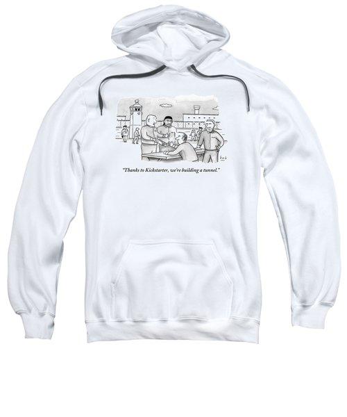 Four Men Converse Outdoors In A Prisoner Sweatshirt