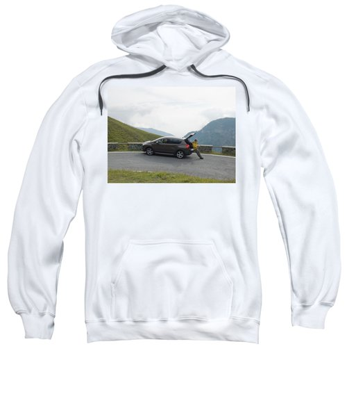 Man Rests On Trunk Of Car On Mountain Sweatshirt
