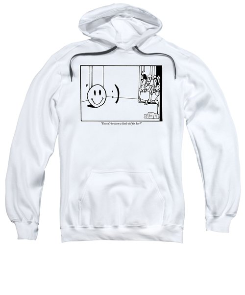 One Traditional Smiley Face Standing Next To An Sweatshirt