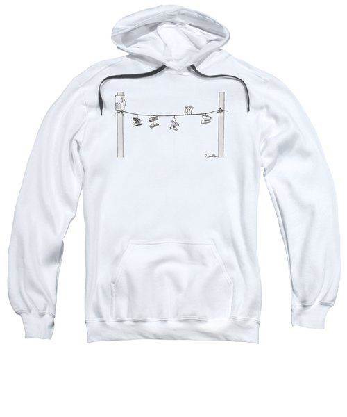 Several Pairs Of Shoes Dangle Over An Electrical Sweatshirt