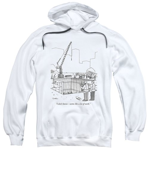 Two Construction Workers Look Out Over A Massive Sweatshirt