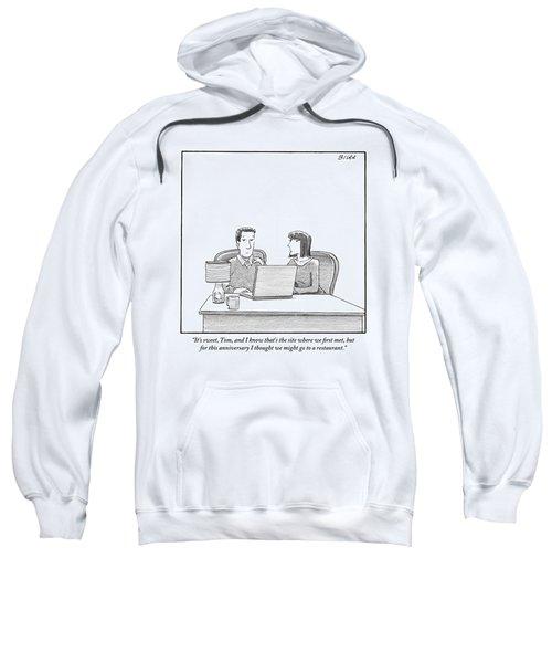 Woman Speaks To Husband As They Sit Behind A Desk Sweatshirt