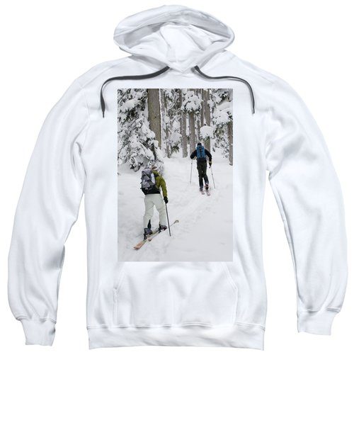 Young Adults Ski-tour Through Forest Sweatshirt