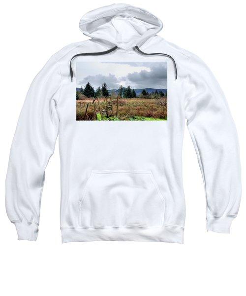 Field, Clouds, Distant Foggy Hills Sweatshirt
